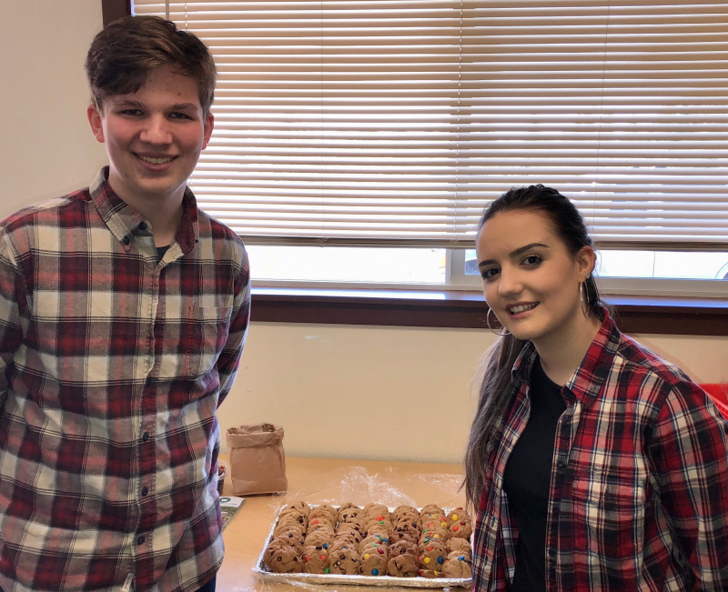 Jonathan and Emily sell cookies to support Shelter Boxes